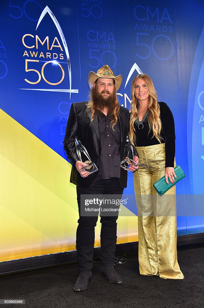 Chris Stapleton and Morgane Stapleton pose with the awards for Male Vocalist of the Year and Video of the Year at the 50th annual CMA Awards at the Bridgestone Arena on November 2, 2016 in Nashville, Tennessee.