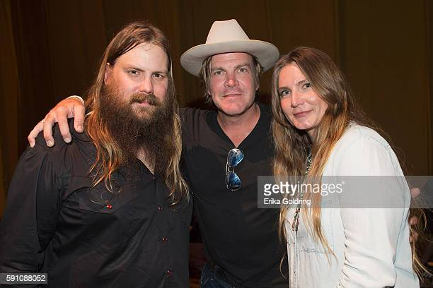 Chris Stapleton, Jack Ingram and Morgane Stapleton gather for a photo backstage at Ryman Auditorium on August 16, 2016 in Nashville, Tennessee.