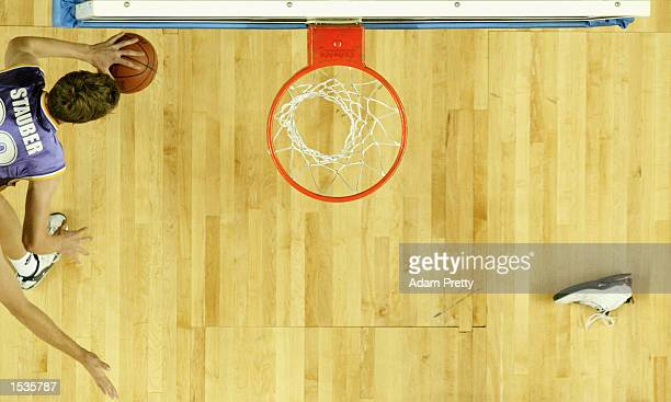 Chris Stauber of the Kings in action while a shoe looks for the rebound during the NBL round 4 match between the Sydney Kings and the Townsville...