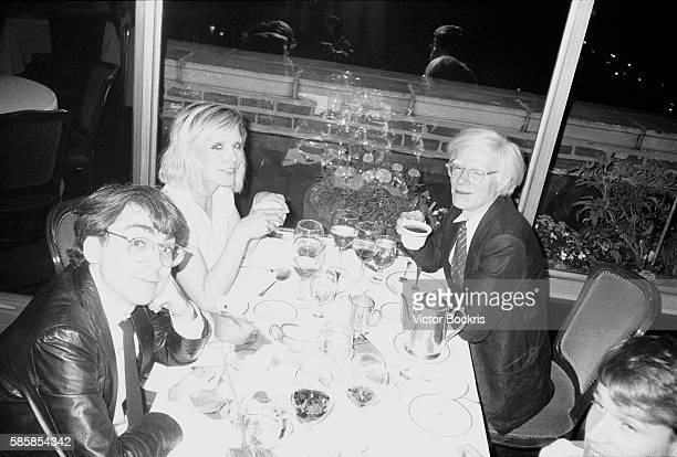 Chris Stein Debbie Harry and Andy Warhol at a restaurant in Harlem