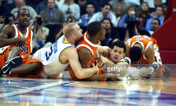 Chris Stephens of Oregon State battles for loose ball with UCLA's Brian Morrison and Jordan Farmar during 7972 firstround victory in the Pacific Life...