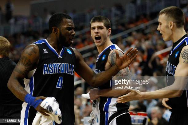 Chris Stephenson of the UNC Asheville Bulldogs celebrates with his teammates on the bench after a play against the Syracuse Orange during the second...