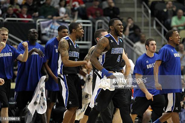 Chris Stephenson of the UNC Asheville Bulldogs celebrates with his teammates after a play against the Syracuse Orange during the second round of the...