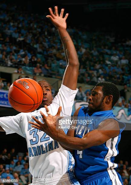 Chris Stephenson of the UNC Asheville Bulldogs looses control of the ball as he drives against Ed Davis of the North Carolina Tar Heels during the...