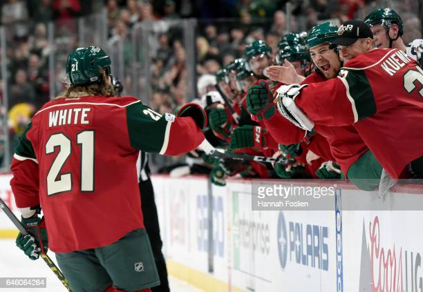 Chris Stewart and Darcy Kuemper of the Minnesota Wild congratulate Ryan White on a goal against the Los Angeles Kings during the second period of the...