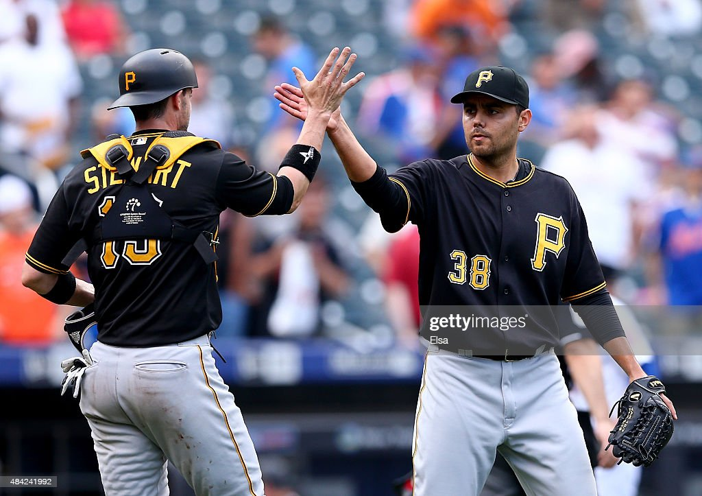 Chris Stewart #19 and Joakim Soria #38 of the Pittsburgh Pirates celebrate the win over the New York Mets on August 16, 2015 at Citi Field in the Flushing neighborhood of the Queens borough of New York City.The Pittsburgh Pirates defeated the New York Mets 8-1.