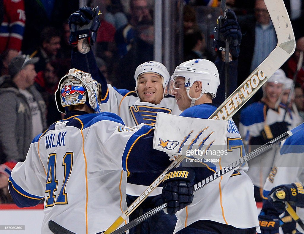 Chris Stewart #25, Jaroslav Halak #41 and Adam Cracknell #79 of the St. Louis Blues celebrate the victory against the Montreal Canadiens during the NHL game on November 5, 2013 at the Bell Centre in Montreal, Quebec, Canada.