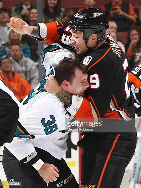 Chris Stewart of the Anaheim Ducks fights against Micheal Haley of the San Jose Sharks on December 4 2015 at Honda Center in Anaheim California