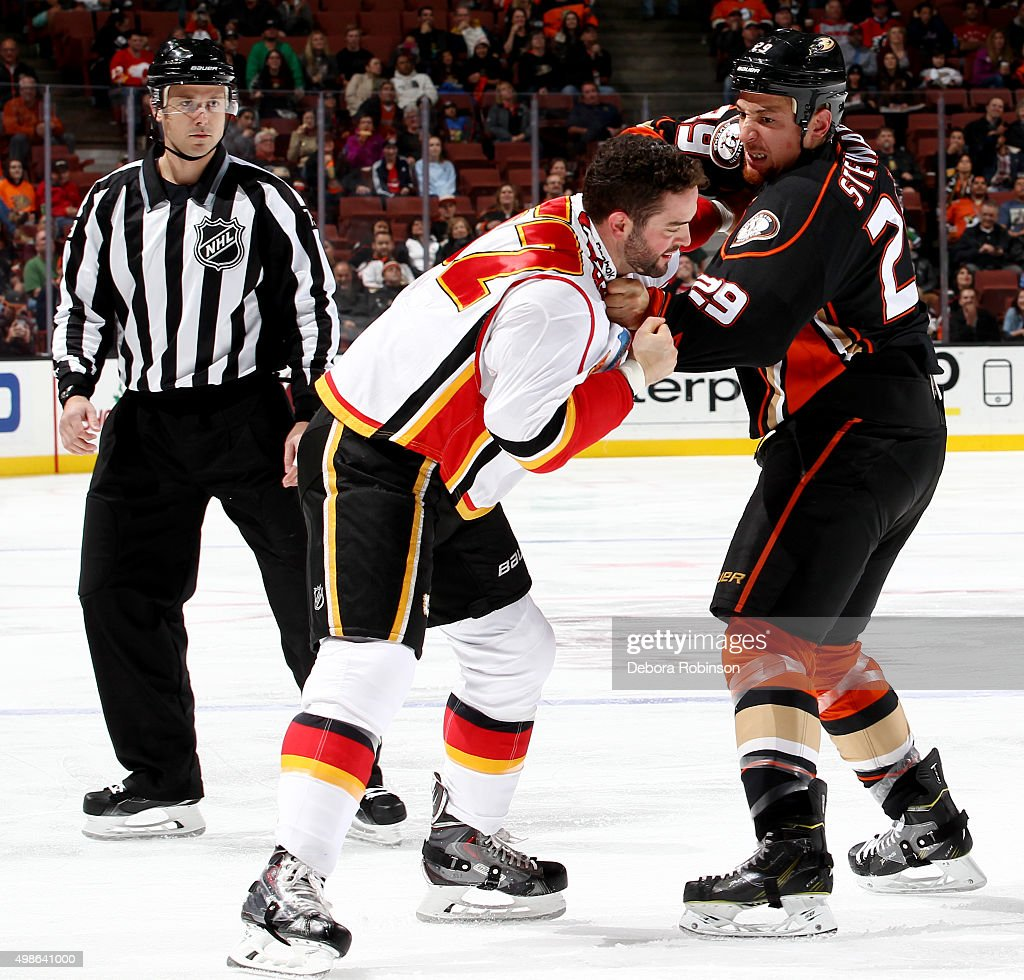 Chris Stewart #29 of the Anaheim Ducks mixes it up with Brandon Bollig #52 of the Calgary Flames on November 24, 2015 at Honda Center in Anaheim, California.
