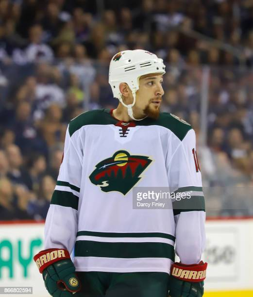 Chris Stewart of the Minnesota Wild looks on during a third period stoppage in play against the Winnipeg Jets at the Bell MTS Place on October 20...