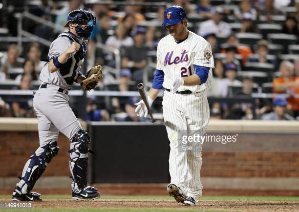 Chris Stewart of the New York Yankees celebrates as Lucas Duda of the New York Mets strikes out in the ninth inning on June 23, 2012 during...