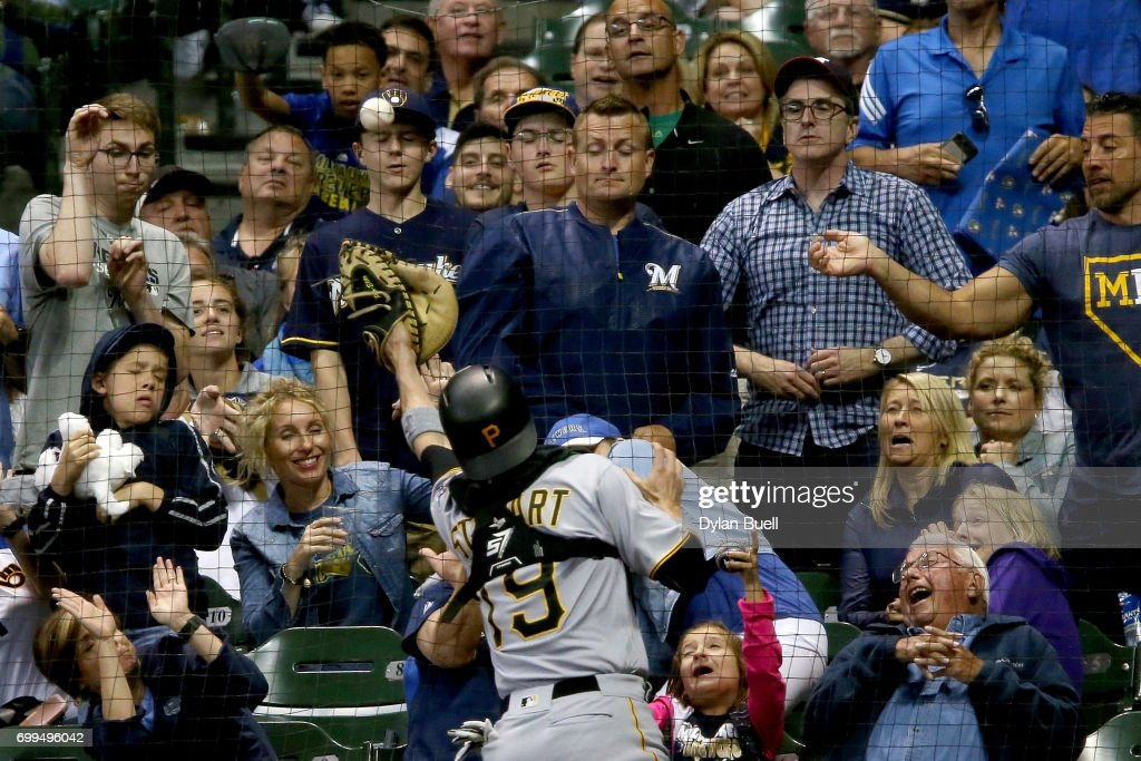Chris Stewart #19 of the Pittsburgh Pirates fails to make a catch against the netting in the seventh inning against the Milwaukee Brewers at Miller Park on June 21, 2017 in Milwaukee, Wisconsin.