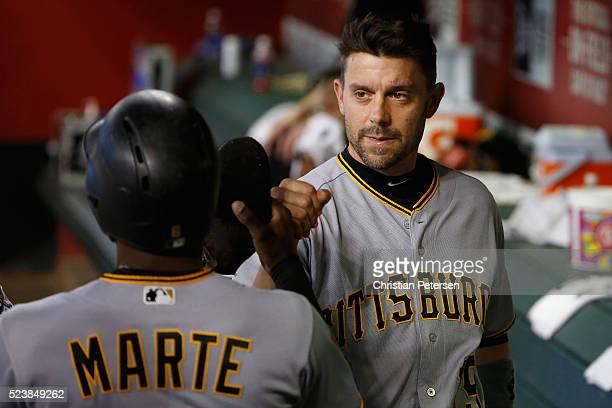 Chris Stewart of the Pittsburgh Pirates highfives Starling Marte after scoring a thirdinning run against the Arizona Diamondbacks during the MLB game...