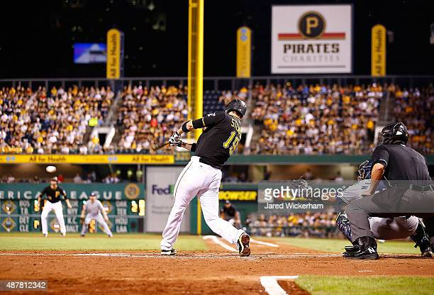 Chris Stewart of the Pittsburgh Pirates hits a two run single in the fourth inning against the Milwaukee Brewers during the game at PNC Park on...