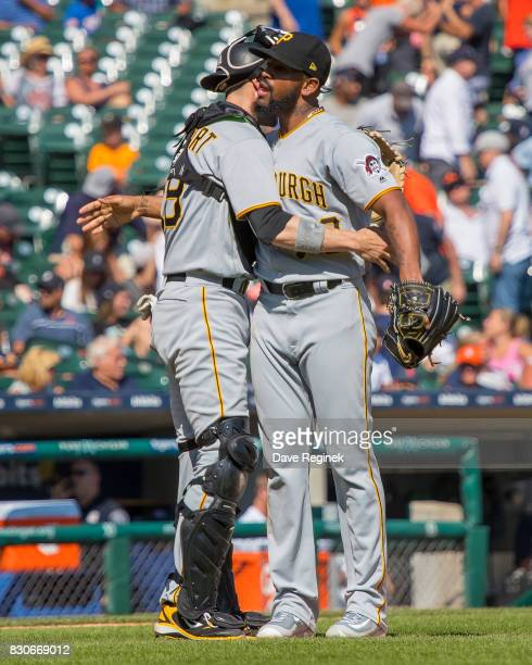 Chris Stewart of the Pittsburgh Pirates hugs teammate relief pitcher Felipe Rivero of the Pittsburgh Pirates after defeating the Tigers 75 during a...