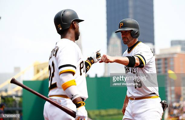Chris Stewart of the Pittsburgh Pirates is congratulated by teammate Andrew McCutchen after scoring in the fifth inning against the Cleveland Indians...