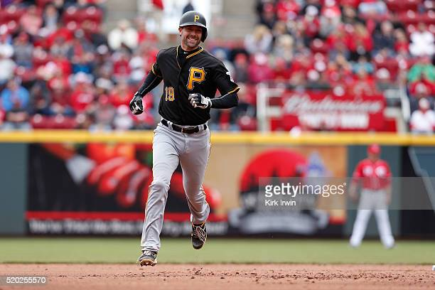 Chris Stewart of the Pittsburgh Pirates rounds second base after hitting a solo home run during the second inning of the game against the Cincinnati...