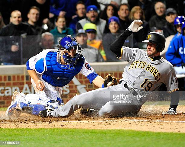 Chris Stewart of the Pittsburgh Pirates scores as Miguel Montero of the Chicago Cubs makes a late tag during the sixth inning on April 29 2015 at...
