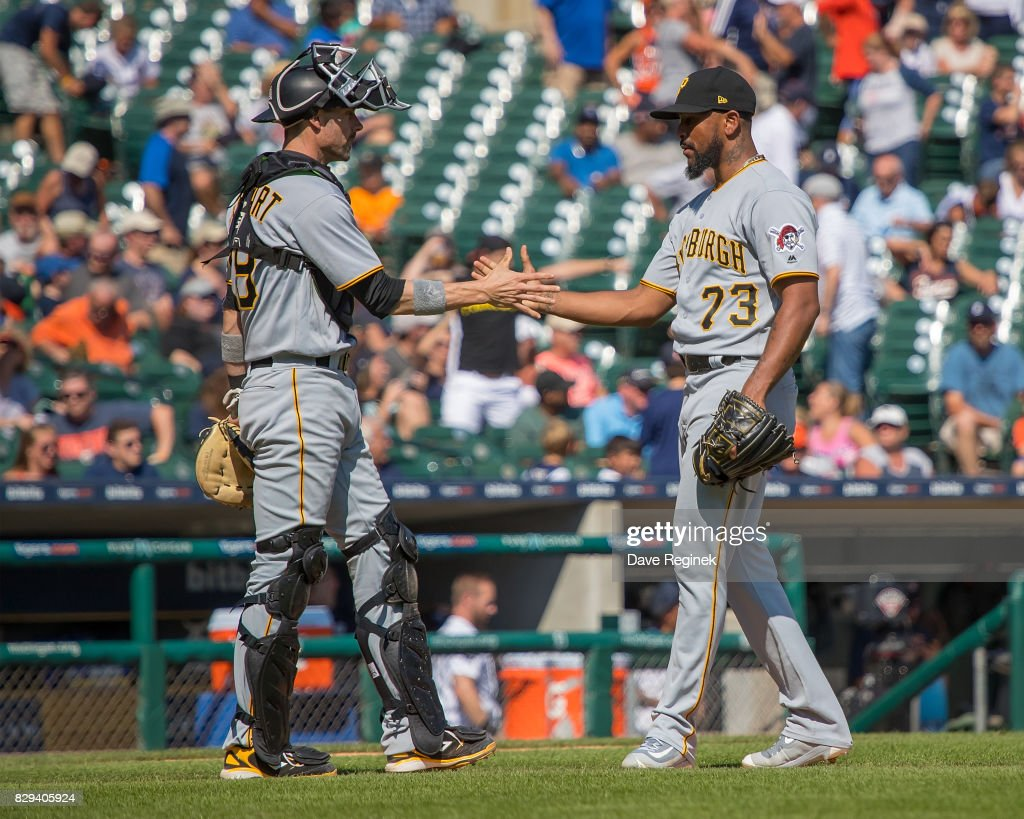 Chris Stewart #19 of the Pittsburgh Pirates slaps hands with relief pitcher Felipe Rivero #73 of the Pittsburgh Pirates after defeating the Tigers 7-5 during a MLB game at Comerica Park on August 10, 2017 in Detroit, Michigan.