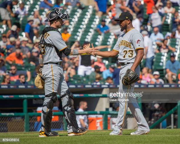 Chris Stewart of the Pittsburgh Pirates slaps hands with relief pitcher Felipe Rivero of the Pittsburgh Pirates after defeating the Tigers 75 during...