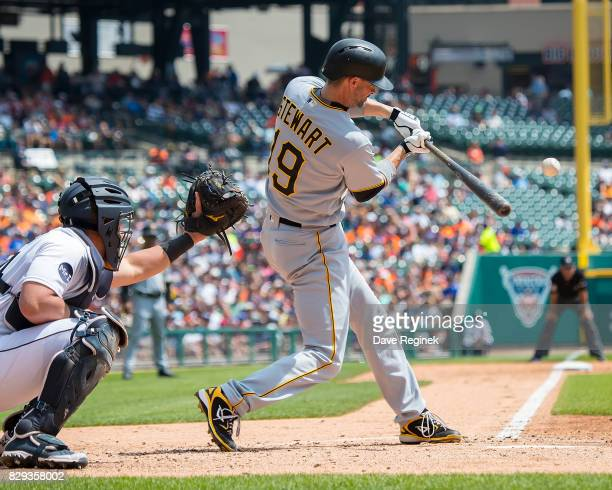 Chris Stewart of the Pittsburgh Pirates swings and makes contact in the second inning against the Detroit Tigers during a MLB game at Comerica Park...