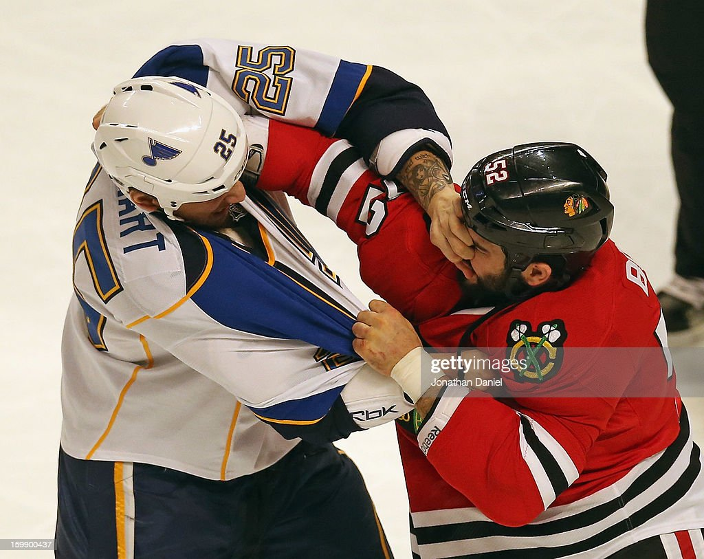 Chris Stewart #25 of the St. Louis Blues sticks his hand into the face of Brandon Bollig #52 of the Chicago Blackhawks during a fight in the first period at the United Center on January 22, 2013 in Chicago, Illinois.