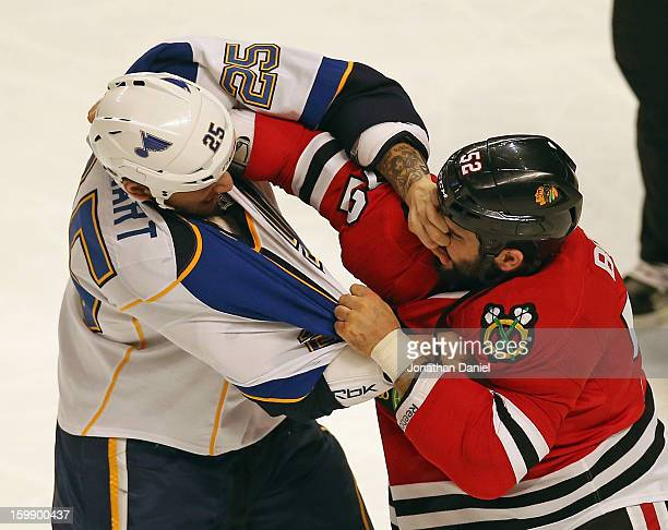 Chris Stewart of the St Louis Blues sticks his hand into the face of Brandon Bollig of the Chicago Blackhawks during a fight in the first period at...