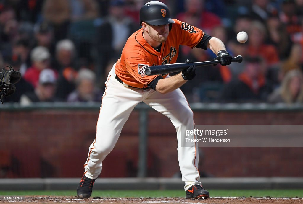 Chris Stratton #34 of the San Francisco Giants sacrifice bunts against the Philadelphia Phillies in the bottom of the fourth inning at AT&T Park on June 1, 2018 in San Francisco, California.