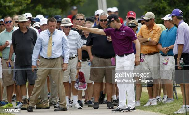 Chris Stroud gets a free drop after hitting into the crowd behind the bleachers on nine during the second round of the Crowne Plaza Invitational at...