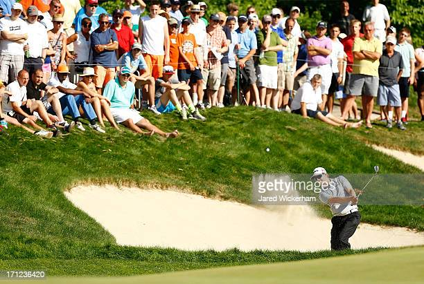 Chris Stroud hits a shot from the bunker on the 15th hole during the final round of the 2013 Travelers Championship at TPC River Highlands on June 23...