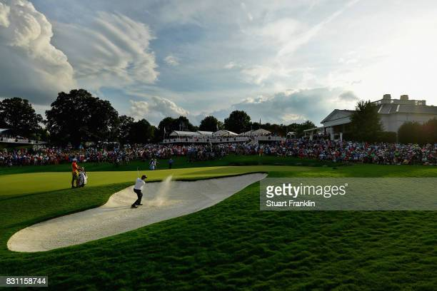 Chris Stroud of the United States plays a shot from a bunker on the 18th hole during the final round of the 2017 PGA Championship at Quail Hollow...
