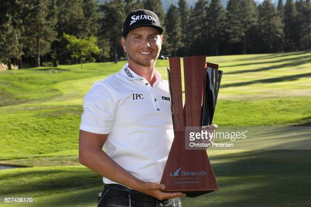 Chris Stroud poses with the trophy after putting in to win during a second playoff hole in the final round of the Barracuda Championship at Montreux...