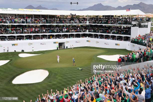 SCOTTSDALE ARIZONA FEBRUARY Chris Stroud reacts to a birdie putt on the 16th green during the third round of the Waste Management Phoenix Open on...