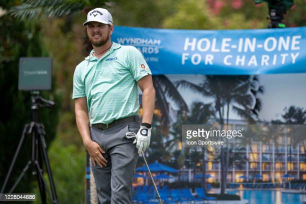 Chris Stroud tees off on the 16th hole during the first round of the Wyndham Championship golf tournament at Sedgefield Country Club in Greensboro,...