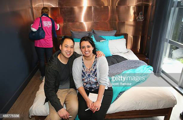 Chris Susetio and Jenna Susetio sit on the bed in their bedroom as 'The Block' contestants offer the public a sneak peak of 'The Block' Glasshouse...