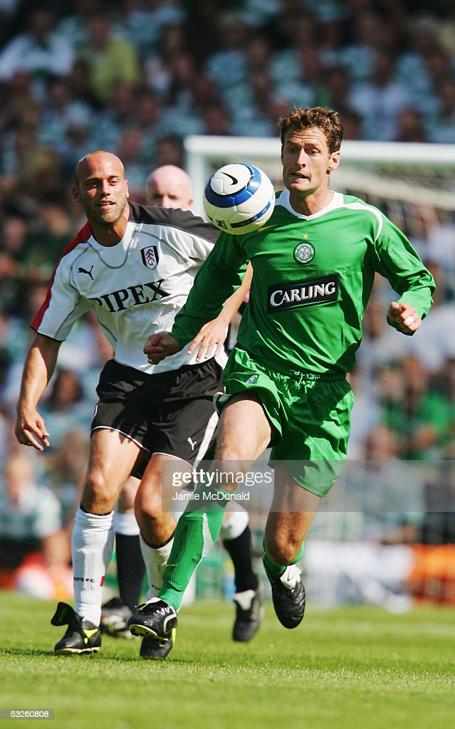 Chris Sutton of Celtic shields the ball from Claus Jensen of Fulham during the pre-season match between Fulham and Celtic at Craven Cottage on July 16, 2005 in Fulham, England.