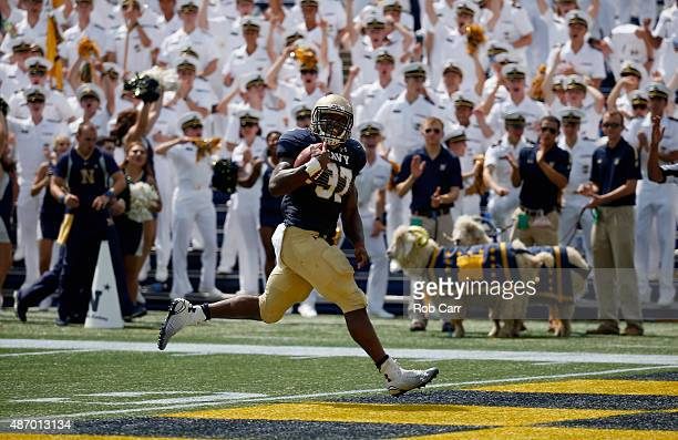 Chris Swain of the Navy Midshipmen scores a touchdown against the Colgate Raiders in the first half at NavyMarine Corps Memorial Stadium on September...