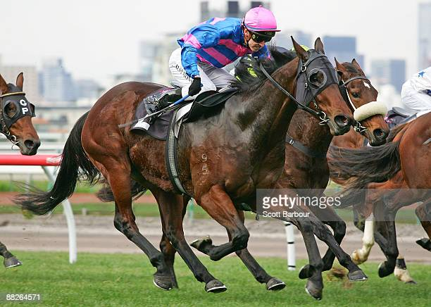Chris Symons riding Arms Wide Open wins race 2 the Carbine Club Handicap during the Queen's Birthday Weekend meeting at Flemington Racecourse on June...