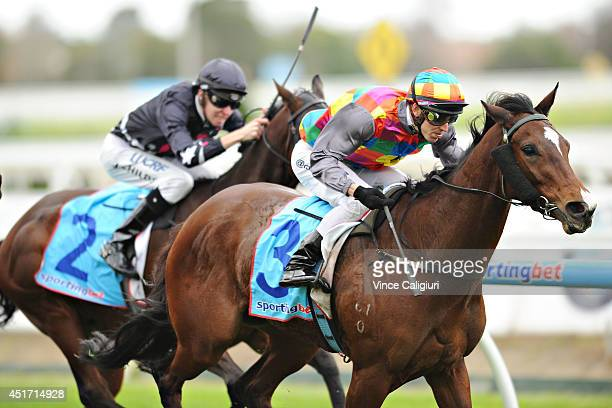 Chris Symons riding Jessy Belle wins Race 4 the SportingbetComau handicap during Melbourne racing at Caulfield Racecourse on July 5 2014 in Melbourne...