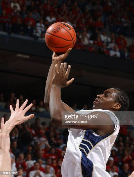 Chris Taft of the University of Pittsburgh Panthers shoots against the University of Wisconsin Madison Badgers during the second round game of the...