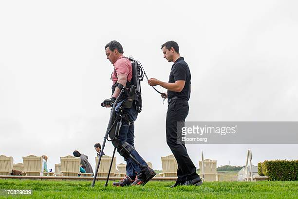Chris Tagatac uses a bionic suit or exoskeleton made by Esko Bionics during the Bloomberg Next Big Thing summit in Half Moon Bay California US on...