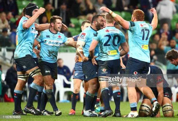 Chris Talakai of the Waratahs Bernard Foley of the Waratahs and their teammates celebrates after the full time siren and winning the round 16 Super...