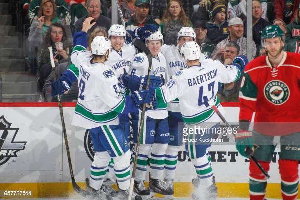Chris Tanev Ben Hutton Brock Boeser Bo Horvat and Sven Baertschi of the Vancouver Canucks celebrate after scoring a goal against the Minnesota Wild...