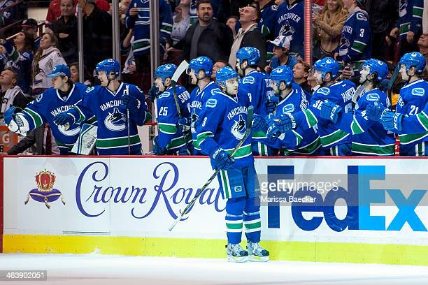 Chris Tanev of the Vancouver Canucks celebrates a goal against the Pittsburgh Penguins on January 7, 2014 at Rogers Arena in Vancouver, British...