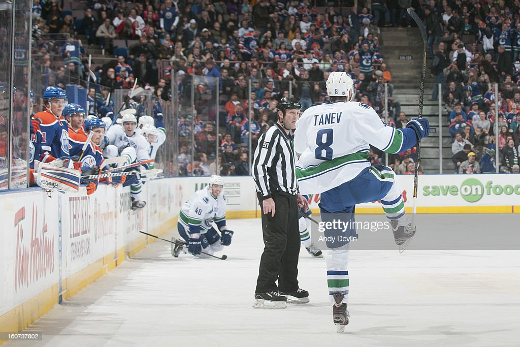 Chris Tanev #8 of the Vancouver Canucks celebrates after scoring in a game against the Edmonton Oilers on February 4, 2013 at Rexall Place in Edmonton, Alberta, Canada.