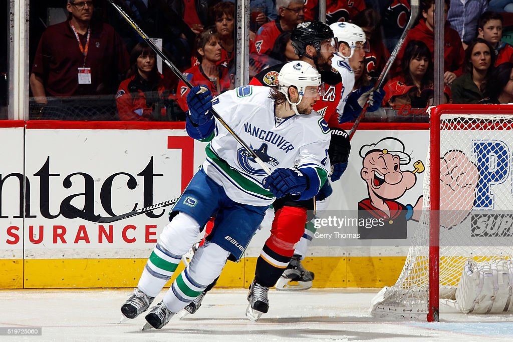 Chris Tanev #8 of the Vancouver Canucks skates against the Calgary Flames during an NHL game on April 7, 2016 at the Scotiabank Saddledome in Calgary, Alberta, Canada.