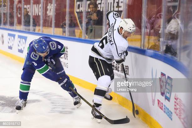 Chris Tanev of Vancouver Canucks skates against Jonny Brodzinski of Los Angeles Kings during the preseason game between the Los Angeles Kings and the...