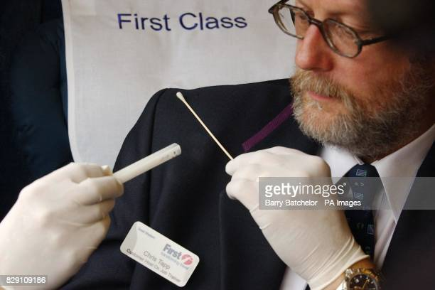 Chris Tapp from First Great Western trains demonstrates taking a sample of spittle from his jacket using a swab from a DNA kit on a train in Bristol...