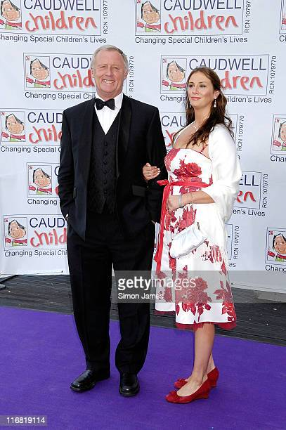 Chris Tarrant and Guest arrive for the Caudwell Children 'The Legends Ball' at Battersea Evolution on May 8 2008 in London England