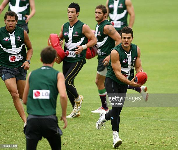 Chris Tarrant handballs during a Fremantle Dockers AFL training session held at Fremantle Oval March 31, 2008 in Perth, Australia.